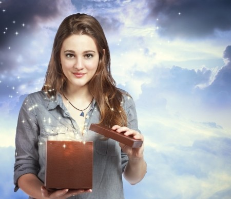 15278638 - beautiful young woman opening a gift box